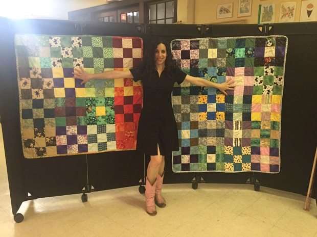 Cyndi with quilts.jpg